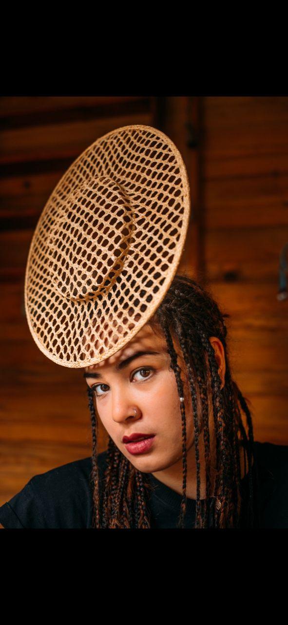 Floating straw hat by Waltraud Reiner