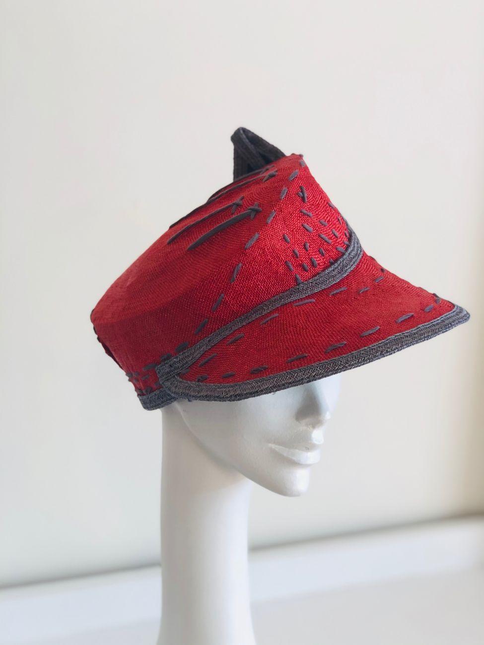 Red straw cap by Waltraud Reiner