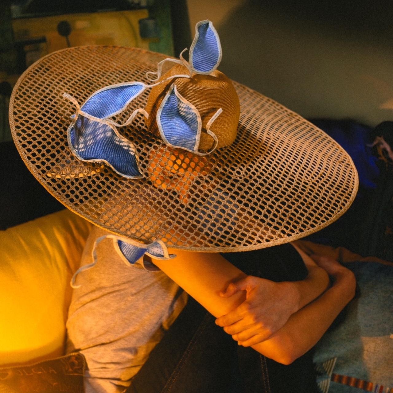 Large straw hat by Waltraud Reiner