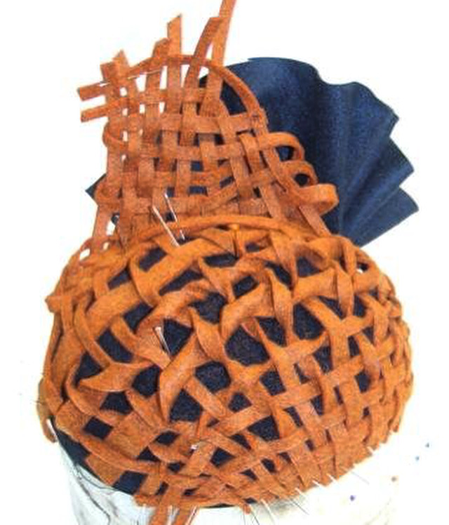 Orange and blue woven headpiece by Waltraud Reiner
