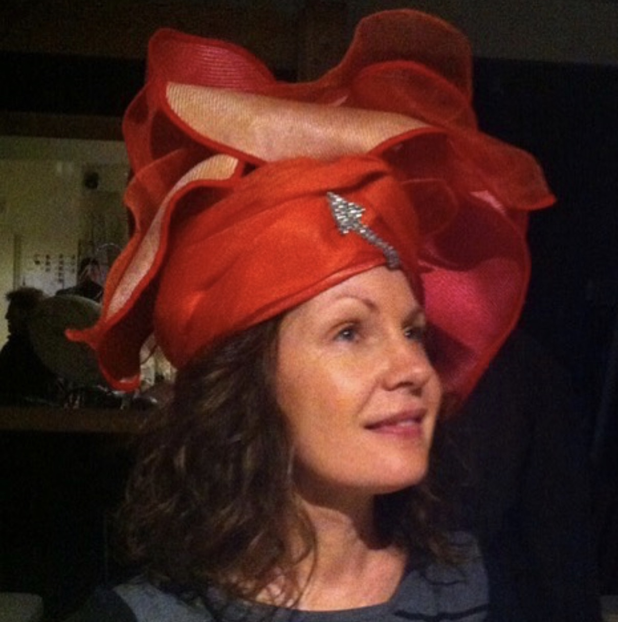 Drapped red hat by Waltraud Reiner